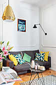 Grey sofa in corner