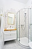 Shower cubicle in bright bathroom