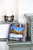 Winter scene in picture frame with knitted cover in jacquard pattern