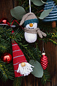 Knitted winter decorations in shapes of gnome and snowman