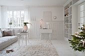 White living room with panelled wainscoting and wintry decorations