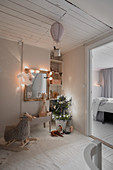 Festive lights in vintage-style nursery decorated in grey