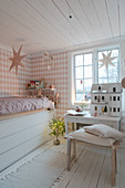 Bed with drawers below in vintage-style child's bedroom