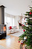 Christmas tree and wood-burning stove in modern living room