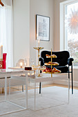 Cake stand and candles on coffee table in modern living room