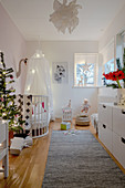 White nursery decorated for Christmas