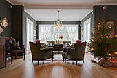 Antique furniture and Christmas tree in classic living room