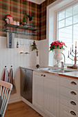 Tartan wallpaper above wainscoting in country-house kitchen