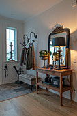 Console table and coat rack in classic foyer