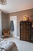 Antique chest of drawers in granny-chic bedroom