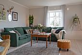 Green corner sofa in classic living room in winter