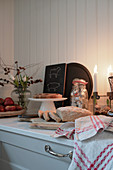 Sliced loaf and cake in wintry country-house kitchen