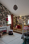 Old sofa and floral wallpaper in vintage-style teenager's bedroom