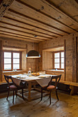 Modern lamp above dining table in rustic farmhouse parlour