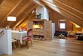 Open-plan interior of modern farmhouse with sloping ceiling