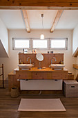Twin sinks on wooden washstand in modern, country-house-style bathroom