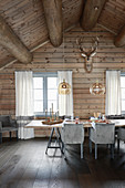 Set table in dining room of elegant log cabin
