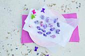 Candied violets on parchment paper