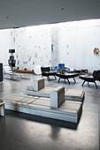 Designer furniture in lounge of industrial loft apartment