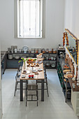 View down into kitchen with industrial-style dining table