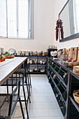 Shelves and angled bins in industrial-style kitchen