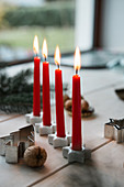 Red Advent candles in star-shaped candle holders