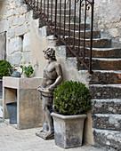Original 18th-century stone steps and classical statue