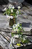 Small bouquets of wood anemones with a grass cuff and lace ribbon