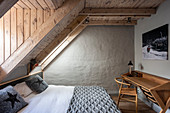 Scandinavian-style double bed and desk in guest room