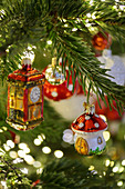 Christmas-tree decorations in shape of fly agaric mushroom and clock tower surrounded by sparkling lights