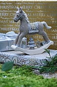 Ornamental rocking horse on wrapped present