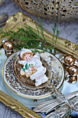 Angel figurine in soup spoon on vintage-style mirrored tray