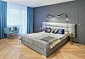 Elegant bedroom in hotel style with graphic pattern on wallpaper
