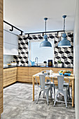 Tiles with graphic pattern in modern kitchen in industrial style
