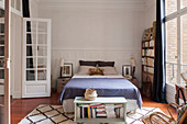 Double bed and bookcase in bedroom