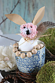Easter bunny made from pompom, egg shell and paper in mug