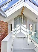 Gallery and glass pitched roof in architect-designed house
