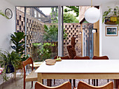 View from dining room into small courtyard garden with decorative brick walls