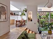 Open-plan, split-level interior with access to small courtyard garden