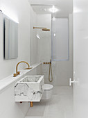 Marble sink and walk-in shower in white, modern, minimalist bathroom