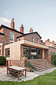 Terrace outside brick house with modern extension