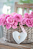 Gift basket with roses, heart pendant, and a 'Good Luck' tag