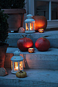 Staircase decorated in autumn with lanterns and pumpkins
