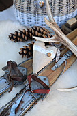 Arrangement of old wooden skis, pine cones, love heart and antlers