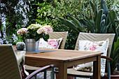 Hydrangea in zinc tub decorating garden table
