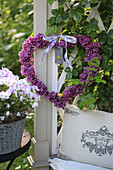 Heart of lilac blossoms tied to philosopher's bench