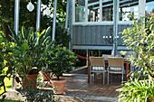 Table and chairs and potted plants on terrace