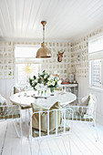 Round table and metal chairs in rustic dining room