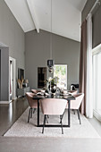 Dining table and pink shell chairs