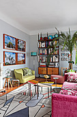 Eclectic, retro living room with graphic rug